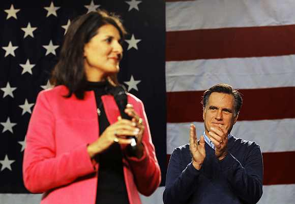 Republican presidential candidate and former Massachusetts Governor Mitt Romney is introduced by South Carolina Governor Nikki Haley during a campaign stop at Pinkerton Academy in Derry, New Hampshire