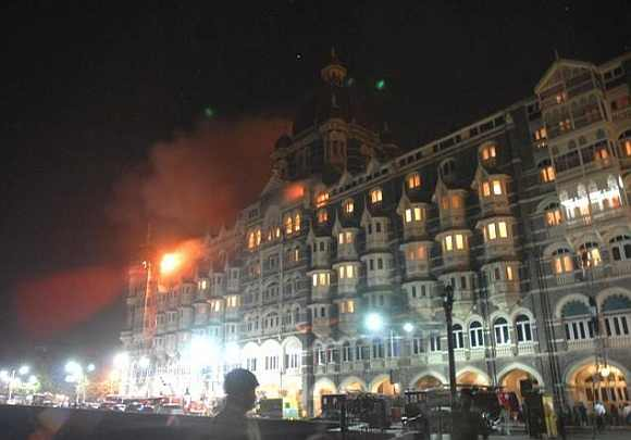 Fire erupts from Taj Mahal Hotel during the 26/11 terror attacks