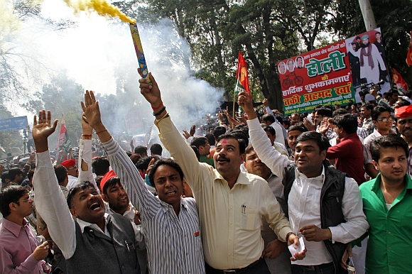 Supporters of Samajwadi Part celebrate outside their party's headquarters in Lucknow