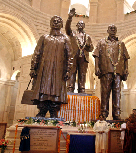 Mayawati poses under the statues of Dalit icons B R Ambedkar, Kanshi Ram and of herself