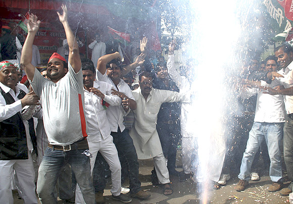 Workers of the Samajwadi Party celebrate in Lucknow