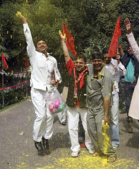 Samajwadi Party supporters celebrate in New Delhi