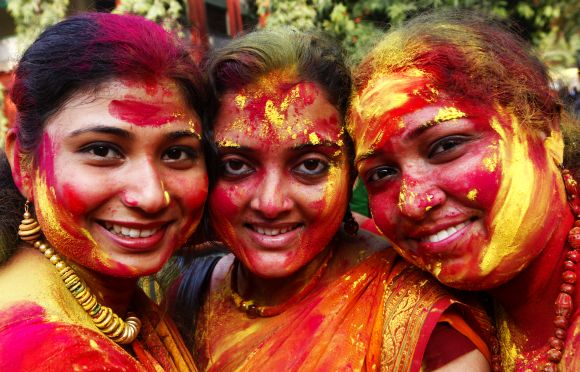 HOLI HAI!! Colourful images from across the world