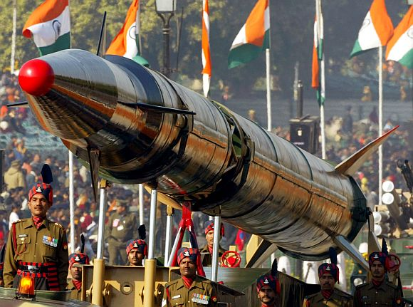 Soldiers stand beside the Agni missile during the Republic Day parade in New Delhi