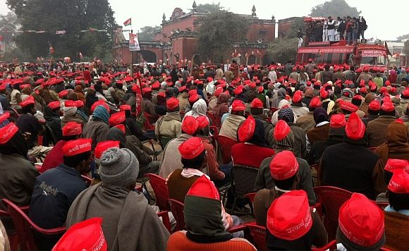 Samajwadi Party supporters listen to Akhilesh Yadav