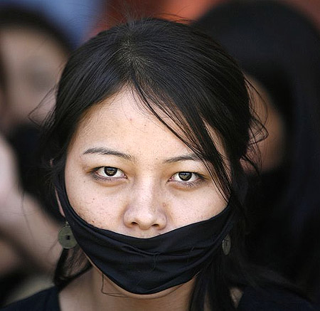 A Manipuri student participates in a protest