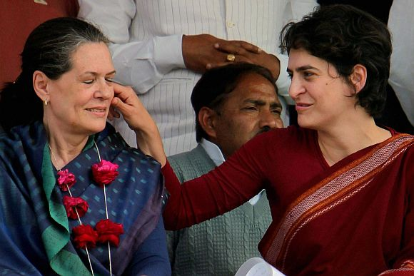 Priyanka Gandhi tweaks her mother Sonia Gandhi's cheeks at an election rally in Amethi