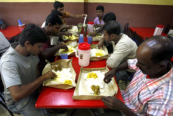 Labourers from Bangladesh eat dinner at a restaurant in Singapore's Little India