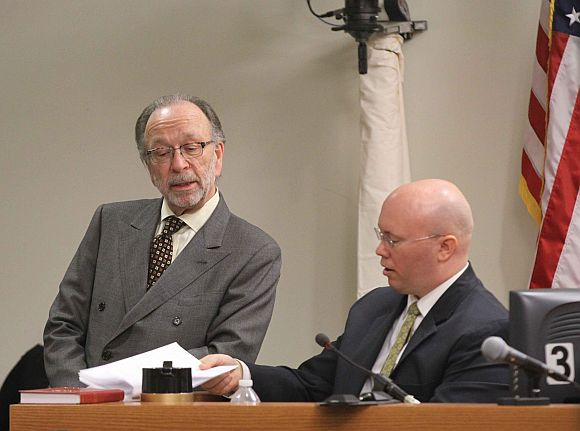 Defence lawyer Steve Altman with investigator Frank DiNinno (seated)