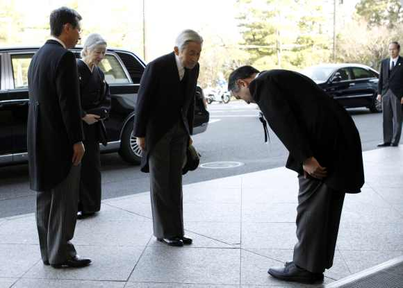 Japan's Emperor Akihito and Empress Michiko arrive for a memorial ceremony marking the first anniversary of the March 11, 2011 earthquake and tsunami, in Tokyo