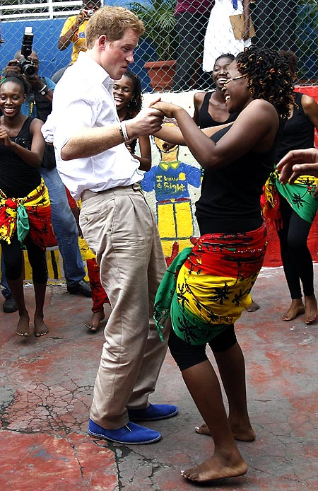 Britain's Prince Harry dances at a youth community center in Kingston, Jamaica