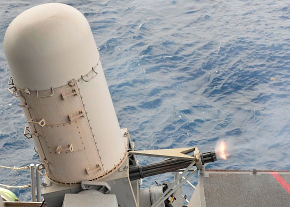 The combat systems department aboard the aircraft carrier USS Enterprise test-fires the close-in weapons system during a pre-action aim calibration fire