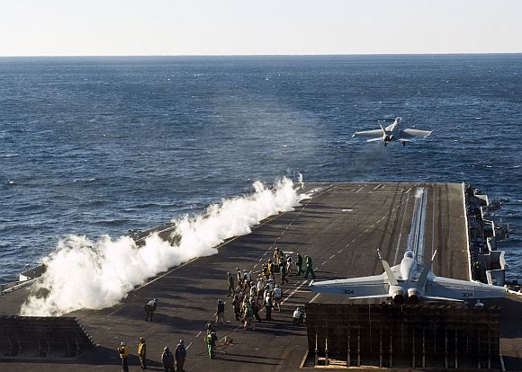 An F/A-18F Super Hornet, assigned to the Red Rippers of Strike Fighter Squadron (VFA) 11, takes off from the flight deck of the aircraft carrier USS Enterprise