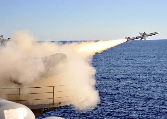 A ship-launched, intercept-aerial guided missile is launched from a NATO Sea Sparrow launcher during a live-fire exercise aboard the aircraft carrier USS Enterprise