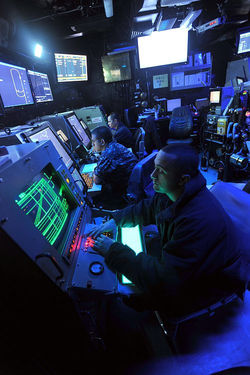 Sailors man their positions in the Carrier Air Traffic Control Centre aboard the aircraft carrier USS Enterprise
