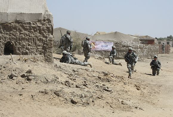A cordon being set up around the abandoned village