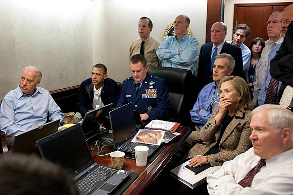 U S President Barack Obama (2nd L) and Vice President Joe Biden (L), along with members of the national security team, receive an update on the mission against Osama bin Laden in the Situation Room of the White House, May 1, 2011