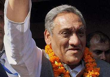 Vijay Bahuguna waves to his supporters