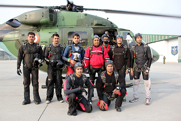 Lt Gen Ramesh Halgali (in red jacket) before boarding the helicopter