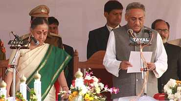 Uttarakhand Governor Margaret Alva administers the oath of office and secrecy to Vijay Bahuguna as the seventh CM of the state