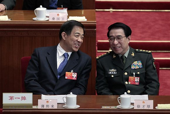 China's Chongqing Municipality Communist Party Secretary Bo Xilai talks with Vice Chairman of China's Central Military Commission Xu Caihou
