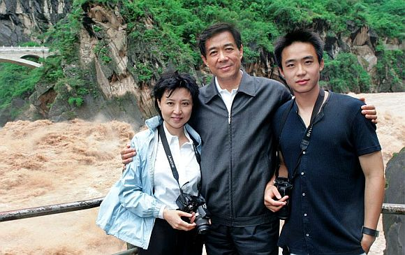 Bo Xilai with his wife Gu Kailai, who has been charged with murder, and his son Bo Guagua, currently a student at Harvard, whose lifestyle has provoked controversy in China