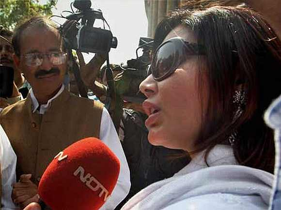 Item girl Rakhi Sawant interacts with the media outside Parliament