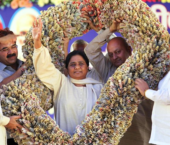 File photograph of former UP chief minister Mayawati receiving a garland made of currency notes from BSP supporters in Lucknow