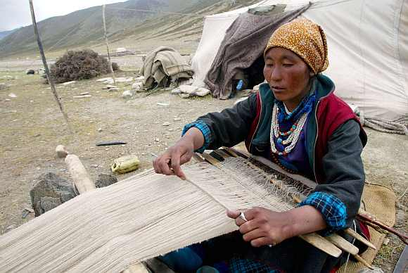 A nomad woman weaves Pashmina at Taglang La in the Ladakh region