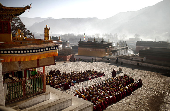 Monks gather to pray at the Labrang monastery in Xiahe county, Gansu Province