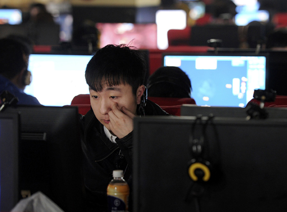 A man uses a computer at an internet cafe in Hefei, Anhui province