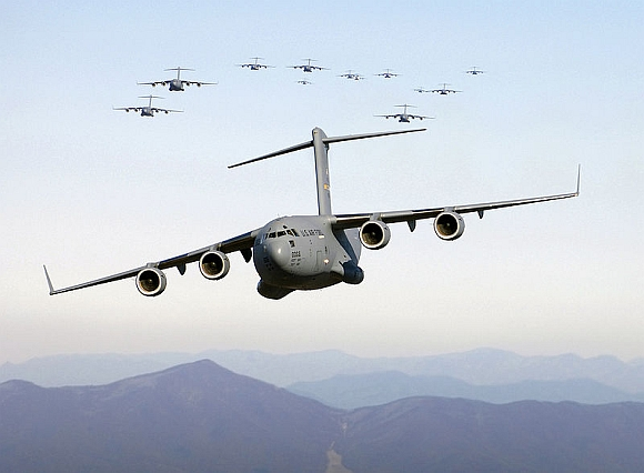 10 C-17 strategic lift aircraft in flight