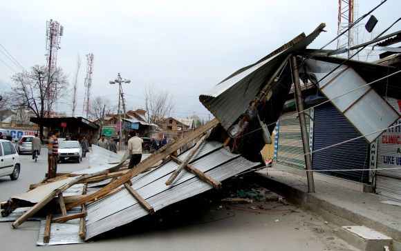 A residential building damaged by the windstorm is seen on the outskirts of Srinagar on Tuesday morning
