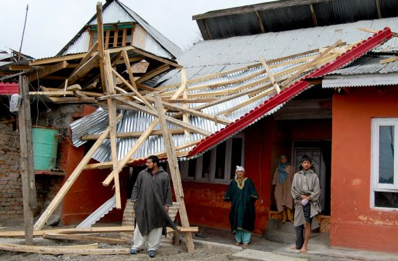 Another residential building devastated by the windstorm in seen in Srinagar