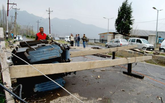 A damaged transformer is seen blocking a road in Srinagar on Tuesday