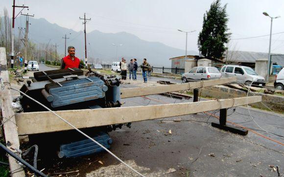 A damaged transformer is seen blocking a road in Srinagar on Tuesday