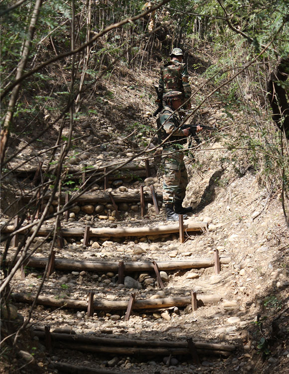 Soldiers walk through a trench used for communication and transporting reinforcements during war.