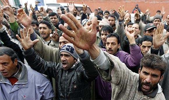 Protestors shout slogans during a rally in Srinagar