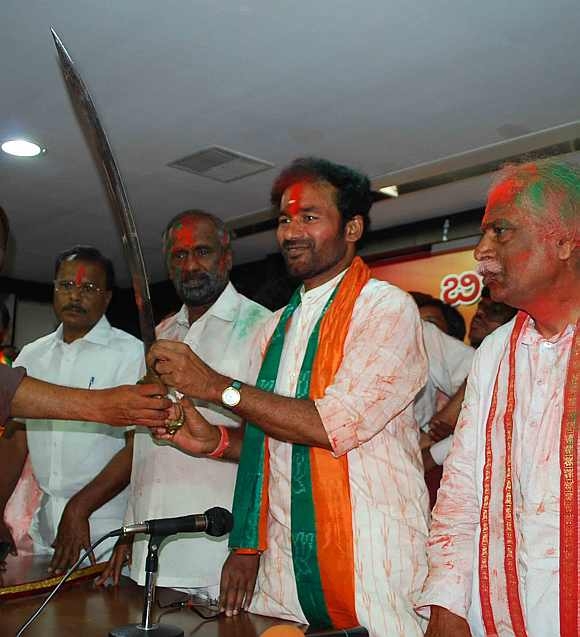 BJP Andhra President  G Kishan Reddy shows a sword after victory in the Mahabubnagar district