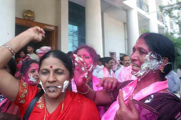 TRS supporters celebrate after the by-poll win