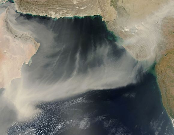 On March 20, 2012, a giant dust plume stretched across the Arabian Sea from the coast of Oman to India. The Moderate Resolution Imaging Spectroradiometer (MODIS) on NASA's Aqua satellite took this picture the same day