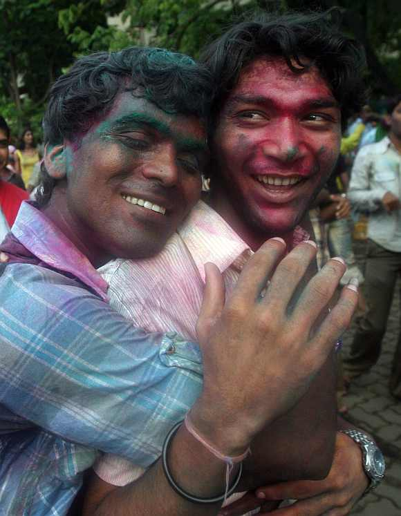 Men celebrate the Delhi court ruling over gay sex during a rally in Mumbai in July 2, 2009