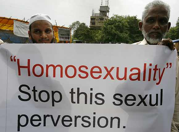Activists of Students of Islamic Organisation hold placards during a demonstration against homosexuality