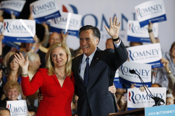 US Republican presidential candidate Romney waves to supporters with his wife Ann in Illinois