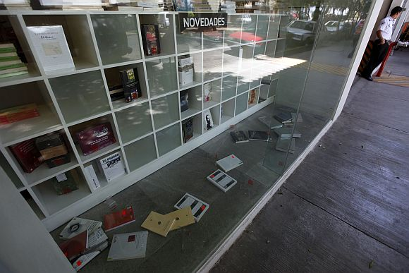 Books are seen on the floor after tremors from an earthquake in the southern state of Guerrero hit the Fondo de Cultura Economica bookstore in Mexico City