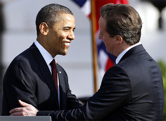 Obama shakes hands with Cameron