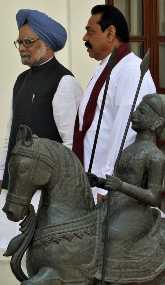 A file photo of Sri Lanka's President Mahinda Rajapakse with Prime Minister Manmohan Singh