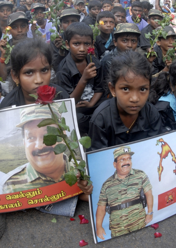 Children hold pictures of slain LTTE leader Vellupillai Prabhakaran during a protest rally against Sri Lanka's President Mahinda Rajapaksa