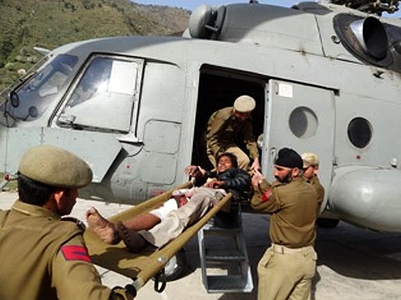 IAF personnel rescue a critically injured victim of the ill-fated bus that met an accident on Saturday near Jammu