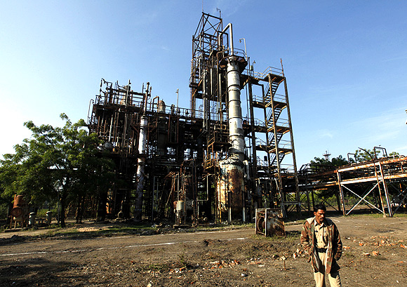 A security guard walks in front of the Union Carbide Corp, now part of Dow Chemical Co, pesticide plant in Bhopal